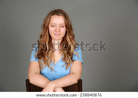headshot of teen girl smiling with eyes closed - stock photo