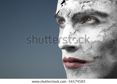 Headshot of the vampire with cracked face. Artistic colors and darkness added