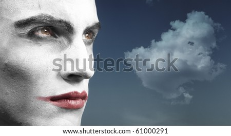 Headshot of the vampyre outdoors and cloud on the background. Artistic colors and darkness added - stock photo