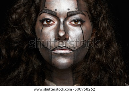 headshot of women with painted face of robot body art