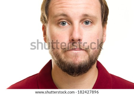 Headshot photo of white Caucasian male with a beard, blue eyes and brown hair. He is closing his mouth to keep silent or mum.