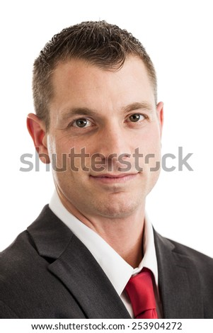 Headshot portrait of a mid 30s businessman wearing suit and tie isolated on a white background