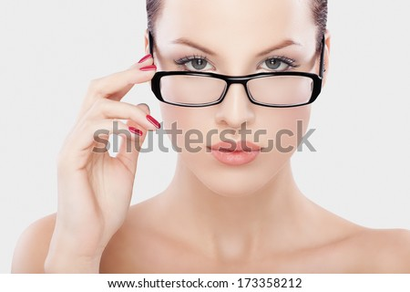 headshot portrait of beautiful women with black glasses,holding fingers on it,.Studio shot.Skin retouching taken with special care.Developed from RAW to give best possible quality  - stock photo