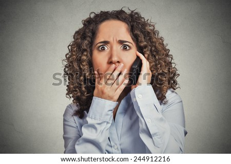 Headshot shocked stunned young woman getting bad news while talking on mobile phone isolated grey wall background. Negative human face expression emotion feelings life perception  - stock photo