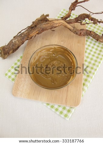 Healing clay paste from water and medicinal clay - stock photo