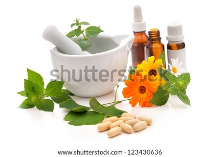 Healing herbs and a mortar. Alternative medicine concept - stock photo
