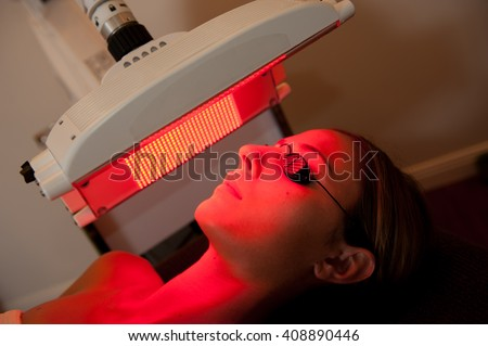 healing red light therapy session - stock photo