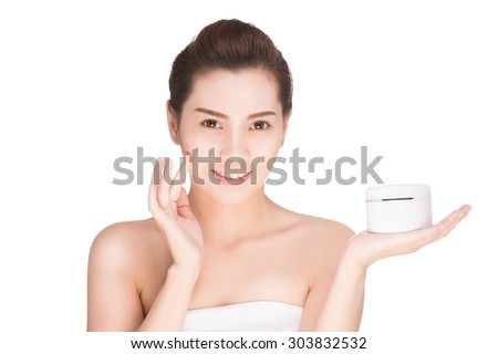 health and beauty concept - Attractive asian woman applying cream on her skin, isolated on white with clipping path. - stock photo