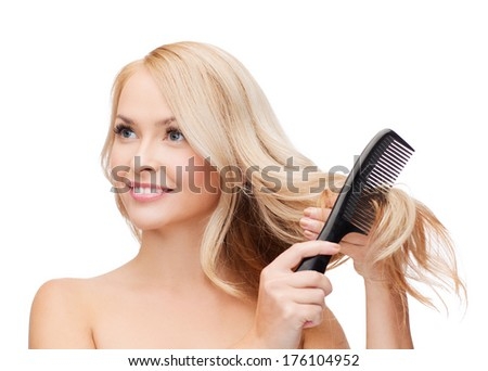 health and beauty concept - beautiful woman with long hair and brush - stock photo