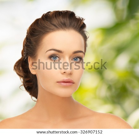 health and beauty concept - face of beautiful bride with evening updo - stock photo