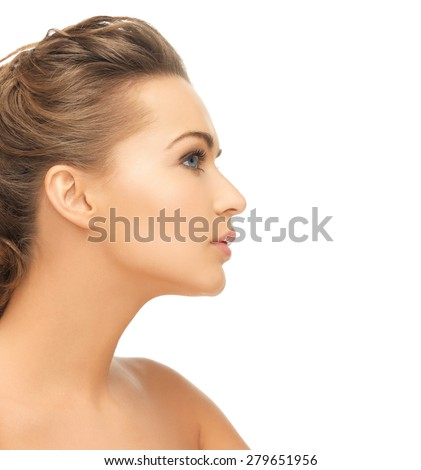 health and beauty concept - face of beautiful bride with evening updo (can be used as a template for jewelry) - stock photo