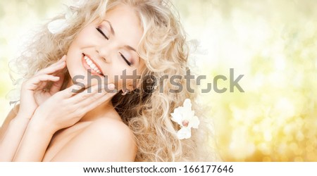 health and beauty concept - happy woman with closed eyes and flowers in hair