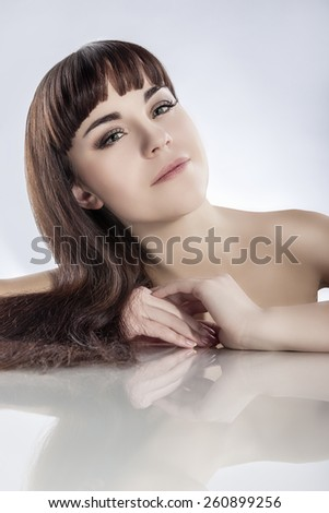 Health and Beauty Concept: Portrait of Young Caucasian Female with Soft Silky Skin and Natural Long Dark hair. Vertical Image - stock photo