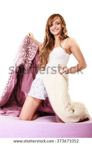 Health and beauty concept. woman lying on mattress underneath the quilt and smiling, Girl relaxing on her bed at morning - stock photo