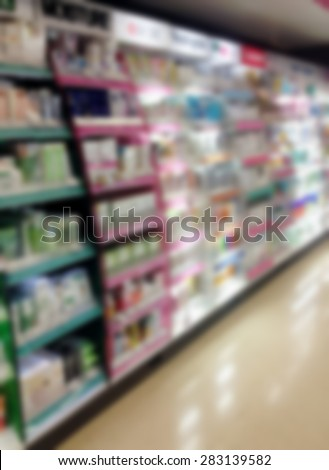 health and beauty shelves in supermarket blur background - stock photo
