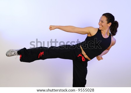 Health and Fitness Self Defense Workout Kick and Punch - stock photo