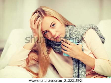 health and illness concept - indoor picture of diseased woman with cup of tea - stock photo