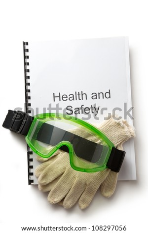 Health and safety register with goggles - stock photo