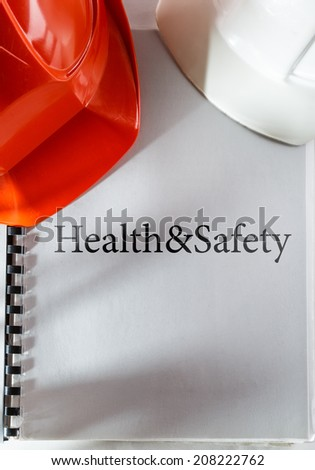 Health and safety with red and white helmets