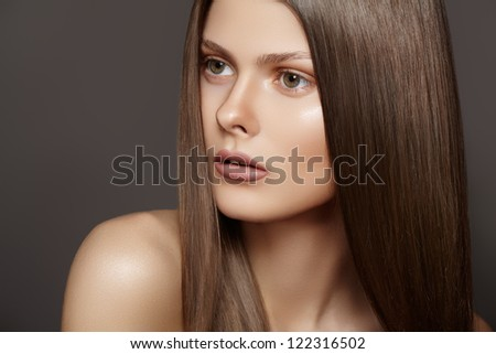 Health, beauty, wellness, haircare, cosmetics and make-up. Beautiful fashion hairstyle. Portrait of woman model with shiny straight long hair and natural make-up - stock photo