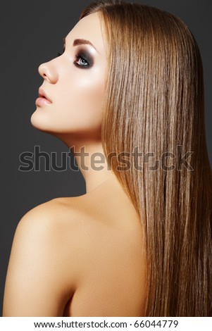 Health, beauty, wellness, haircare, cosmetics and make-up. Beautiful fashion hairstyle. Portrait of woman model with shiny straight long hair and evening make-up.