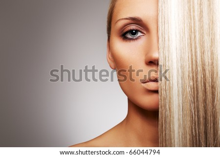 Health, beauty, wellness, haircare, cosmetics and make-up. Beautiful fashion hairstyle. Portrait of glamour sunburnt woman model with shiny straight long blond hair and natural make-up. - stock photo