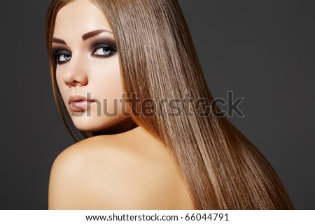Health, beauty, wellness, haircare, cosmetics and make-up. Beautiful fashion hairstyle. Woman model with shiny straight long hair and evening make-up.