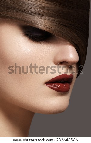 Health, beauty, wellness, haircare, cosmetics and make-up. Beautiful woman model with shiny straight long hair and fashion bright makeup. Sexy girl with dark red lips & smooth hairstyle  - stock photo