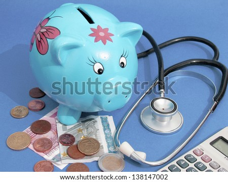 health care costs - Stethoscope on money and piggy bank - stock photo