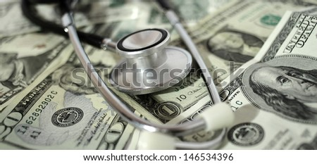 health care costs - Stethoscope on money background
