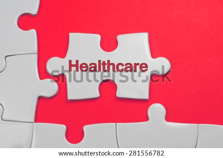 Health Care on white puzzle - Business Concept - stock photo