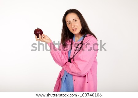 Health care provider doctor suggests an apple for healthy living - stock photo