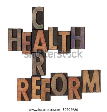 health care reform crossword in vintage wooden letterpress types stained in ink, isolated on white