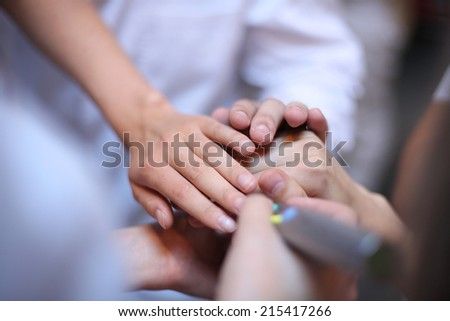 Health care workers demonstrating unity; teamwork concept - stock photo