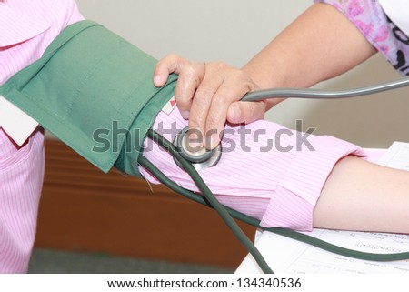 health checking doctor measure blood preasure