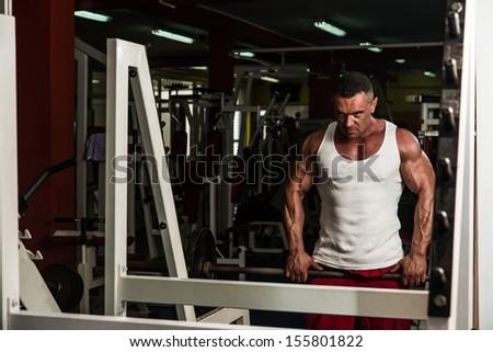 Health Club Workout Trap Exercises - stock photo
