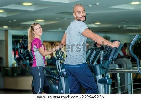 Health & Fitness. Athletes use fitness equipment in the gym and in the camera. - stock photo