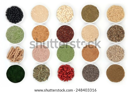 Health food and body building powders in porcelain dishes over white background.   - stock photo