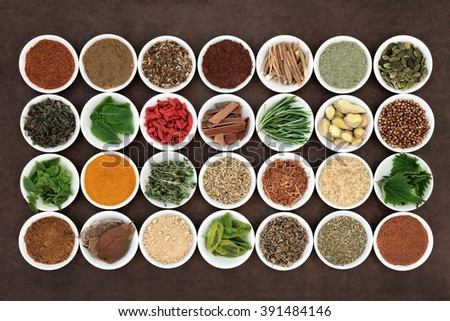 Health food and herb selection for men in white porcelain bowls over lokta paper background. - stock photo