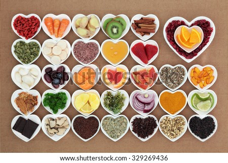 Health food for flu and cold remedy cures high in antioxidants and vitamin c with tablets, medicinal herbs and spices in heart shaped dishes.  - stock photo