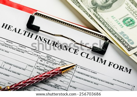 Health insurance application form with banknote concept for life planning  - stock photo