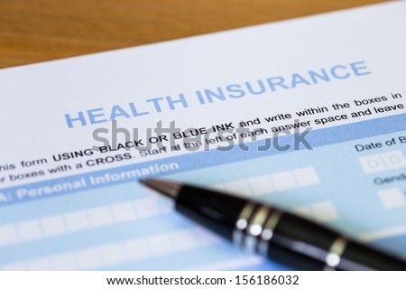 Health insurance application form with pen concept for life planning - stock photo