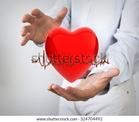 health insurance concept: 3d hearth with electro between hands - stock photo