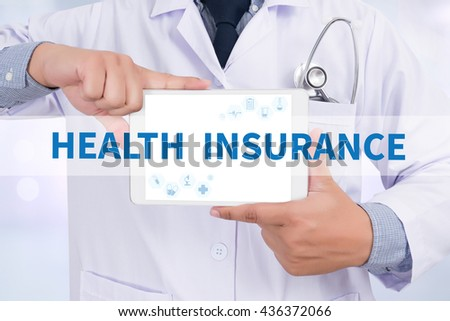 HEALTH INSURANCE Doctor holding  digital tablet - stock photo