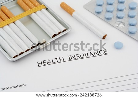 health insurance document with pills and cigarettes - stock photo