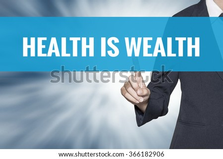 Health is Wealth word on virtual screen touch by business woman cyan sky tab - stock photo