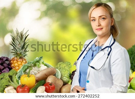 Health. Medical doctor woman over Diet and health care background. - stock photo