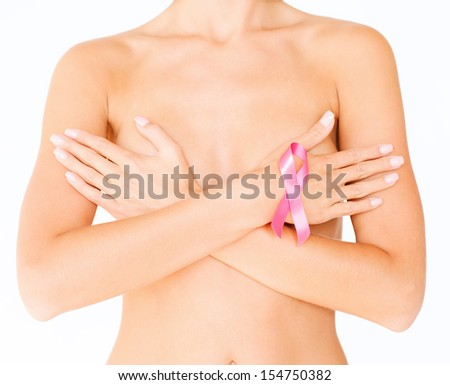 health, medicine, beauty concept - naked woman with breast cancer awareness ribbon - stock photo