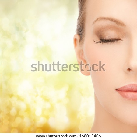 health, spa and beauty concept - close up of face of beautiful young woman - stock photo