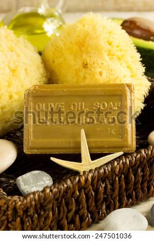 health spa setting, olive oil soap,sponge,avocado - stock photo